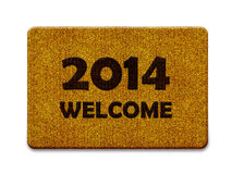 Happy New year. 2014, welcome doormat carpet isolated on white. the same concept available for 2015 and 2016 year. (clipping path included Royalty Free Stock Images