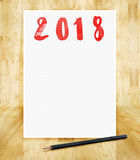 Happy new year 2018 on white paper frame with pencil in hand bru stock photos