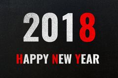 2018 Happy New Year, white and red colored chalk text on black Royalty Free Stock Images