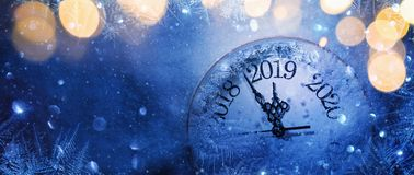 Happy New Year 2019. Winter Celebration. Happy New Years 2019. Winter Celebration With Dial Clock On Snow And Light stock images