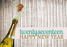 2017 happy new year wishes with opened champagne bottle stock photography