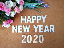 Happy New Year 2020 wishes with a vintage roses background. A colorful Happy New Year 2020 wishes with a vintage roses background stock images