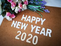 Happy New Year 2020 wishes with a vintage roses background. A colorful Happy New Year 2020 wishes with a vintage roses background royalty free stock photography