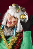 Happy New Year Woman. Festive decorated woman with open mouth. Studio shot against a red background Stock Photos