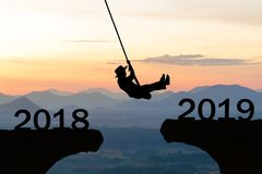 Happy New Year 2019 Woman rope jump cliff stock photography