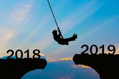 Happy New Year 2019 Woman rope jump cliff stock photo