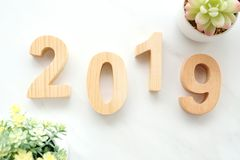 2019 happy new year wood letters on white marble background, 2019 new year greeting card banner stock photos