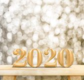 2020 happy new year wood number 3d rendering on wood table with sparkling gold bokeh wall,leave space for display or montage of royalty free stock photo