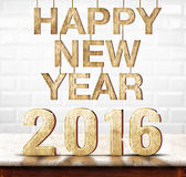Happy New Year 2016 wood texture on marble table with white cera Stock Image