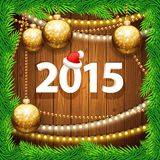 Happy New Year 2015 on Wooden Background with. Christmas Baubles. Used pattern brushes included. Clipping paths included in additional jpg format Royalty Free Stock Images