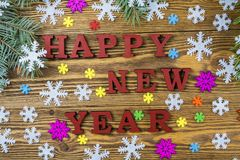 Happy New Year on a wooden background. Royalty Free Stock Image