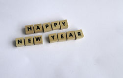 Happy new year. Wooden blocks on white background spelling HAPPY NEW YEAR Stock Images