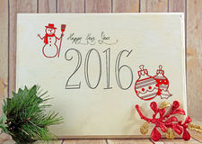Happy New Year. A wooden board with Happy New Year and Christmas decorations Stock Image