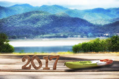Happy new year 2017 on wooden plank and mountain landscape view background Royalty Free Stock Photography