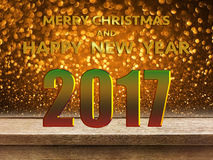 Happy New Year 2017 on wooden table with gold glitter bokeh back. Happy New Year 2017 on wood table with gold glitter bokeh background Royalty Free Stock Photos