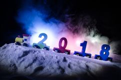 2018 happy new year,wooden toy train carrying numbers of 2018 year on snow. Toy train with 2018. Copy space. Christmas decoration. Royalty Free Stock Images
