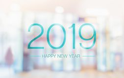 Happy new year 2019 word on blur pale color convention hall office building bokeh background. Happy new year 2019 word on blur pale color convention hall office royalty free stock photo