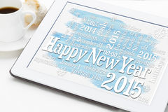 Happy New Year 2015. Word cloud on a digital tablet with a cup of coffee Royalty Free Stock Images