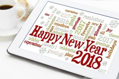 Happy New Year 2018 word cloud. Happy New Year 2018 greetings card  - word cloud on a digital tablet with a cup of coffee Stock Images