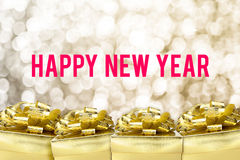 Happy new year word with Golden gift box with ribbon and colorfu Royalty Free Stock Photo