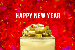 Happy new year word with Golden gift box with ribbon and colorfu Stock Photos