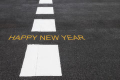 Happy new year words on asphalt road Stock Images