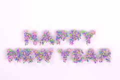 Happy New Year words from colorful balls on white background. New Year sign. 3D rendering illustration Stock Photography
