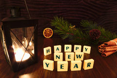 Happy New Year words with flashlight candle, star, pine branch, cinnamon and orange Stock Images