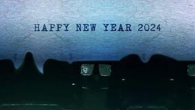Happy New Year 2024 words Typing on paper old vintage typewriter.