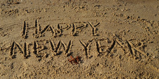 Happy New Year in Beach Sand Stock Images