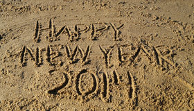 Happy New Year 2014 on Beach  Stock Photos