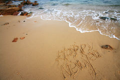 Happy new year write on beach Royalty Free Stock Photography