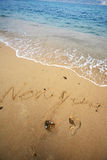 Happy new year write on beach Royalty Free Stock Images