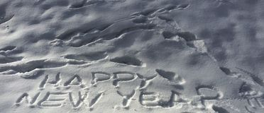 Happy New year. Write on the snow Stock Image
