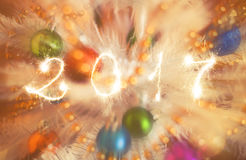 Happy new year 2017 writing sparkles firework with christmas defocused light bokeh background Royalty Free Stock Photos