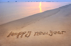 Happy new year written in beach Stock Photography