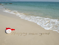 Happy new year written in beach Royalty Free Stock Images