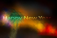 Happy New Year concept.Happy new year written on a colorful abstract background. Happy New year written on the blurred colorful back ground for the future and Royalty Free Stock Photo