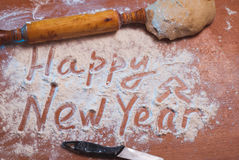 Happy New Year written on the flour, Royalty Free Stock Photos