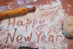 Happy New Year written on the flour, Royalty Free Stock Photography