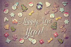 Happy New Year! written among gingerbread cookies. Vintage look added. Royalty Free Stock Photo