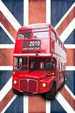 Happy new year 2019 written on a London red bus, Union Jack background. Happy new year 2019 written on a London vintage red bus, Union Jack background royalty free stock photos