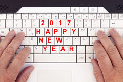 Happy new year 2017 written replaced on a modern keyboard. Happy new year 2017 written replaced on an modern laptop keyboard royalty free stock photo