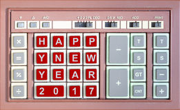 Happy new year 2017 written replaced on an old keypad. Happy new year 2017 written replaced on an old calculator keypad royalty free stock photo