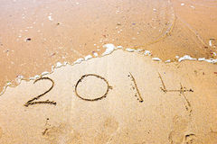 Happy New Year, 2014 written in sand Stock Photos