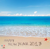 Happy new year 2017 written in the sand. `happy new year 2017` written on a tropical beach