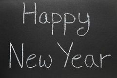 Happy New Year written on a school blackboard. Stock Image