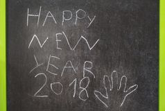 Happy New Year 2018. Written by small child with chalk on the blackboard. concept of children art Royalty Free Stock Images