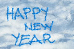 Happy new year written in the snow Stock Image