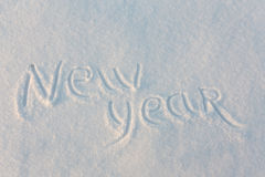 Happy New Year written on snow. Happy New Year greetings written on snow Royalty Free Stock Image